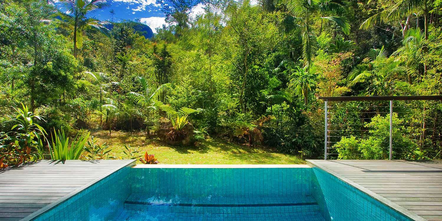 The large private deck of Cedar Lodge has a private heated plunge pool with rainforest views