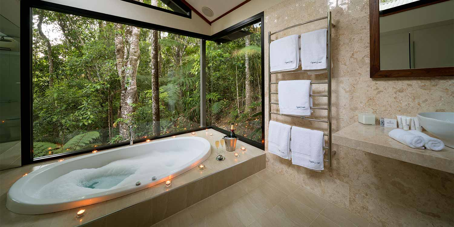 The double spa bath in the marble bathroom of Carabeen, one of our Creekside Spa Cabins