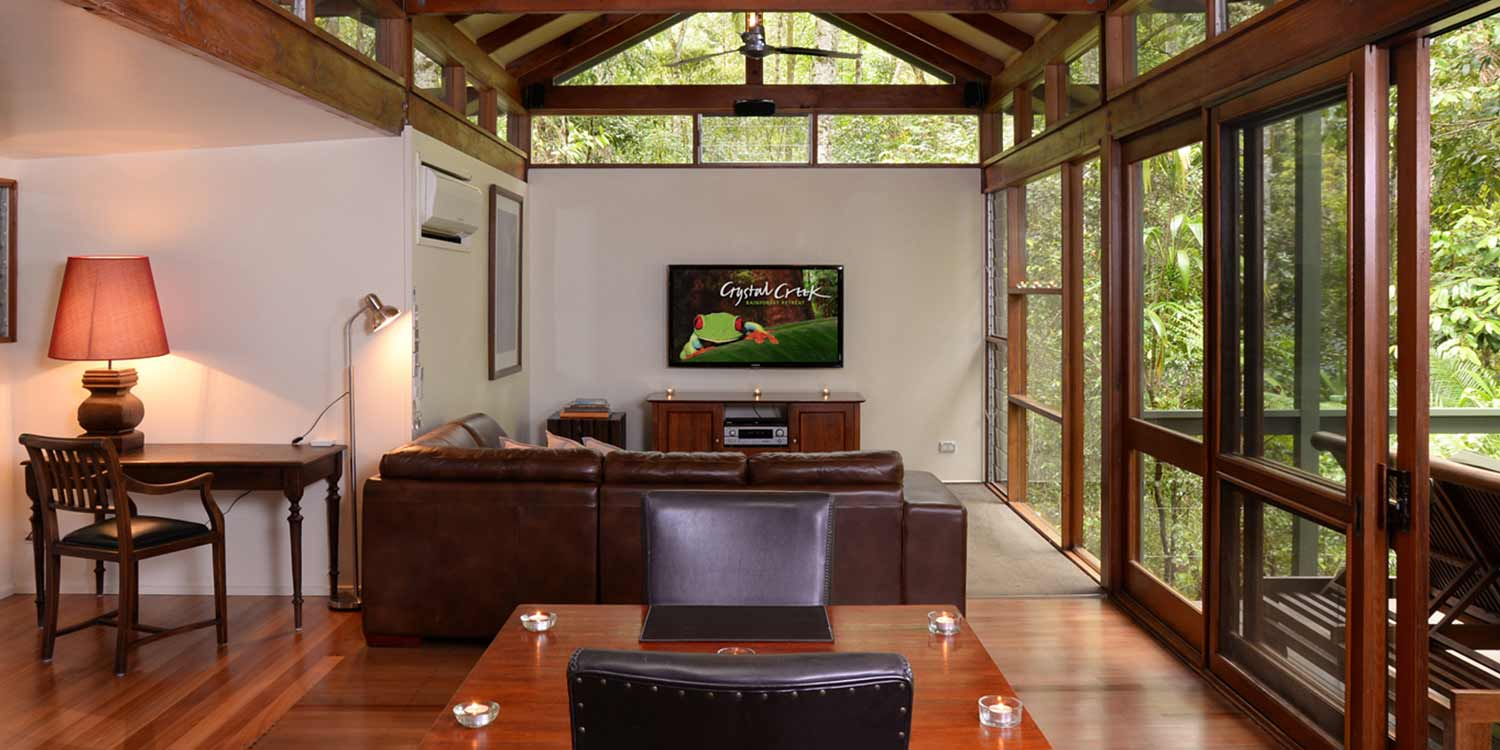 Creekside Spa Cabins have floor to ceiling rainforest views in the lounge area