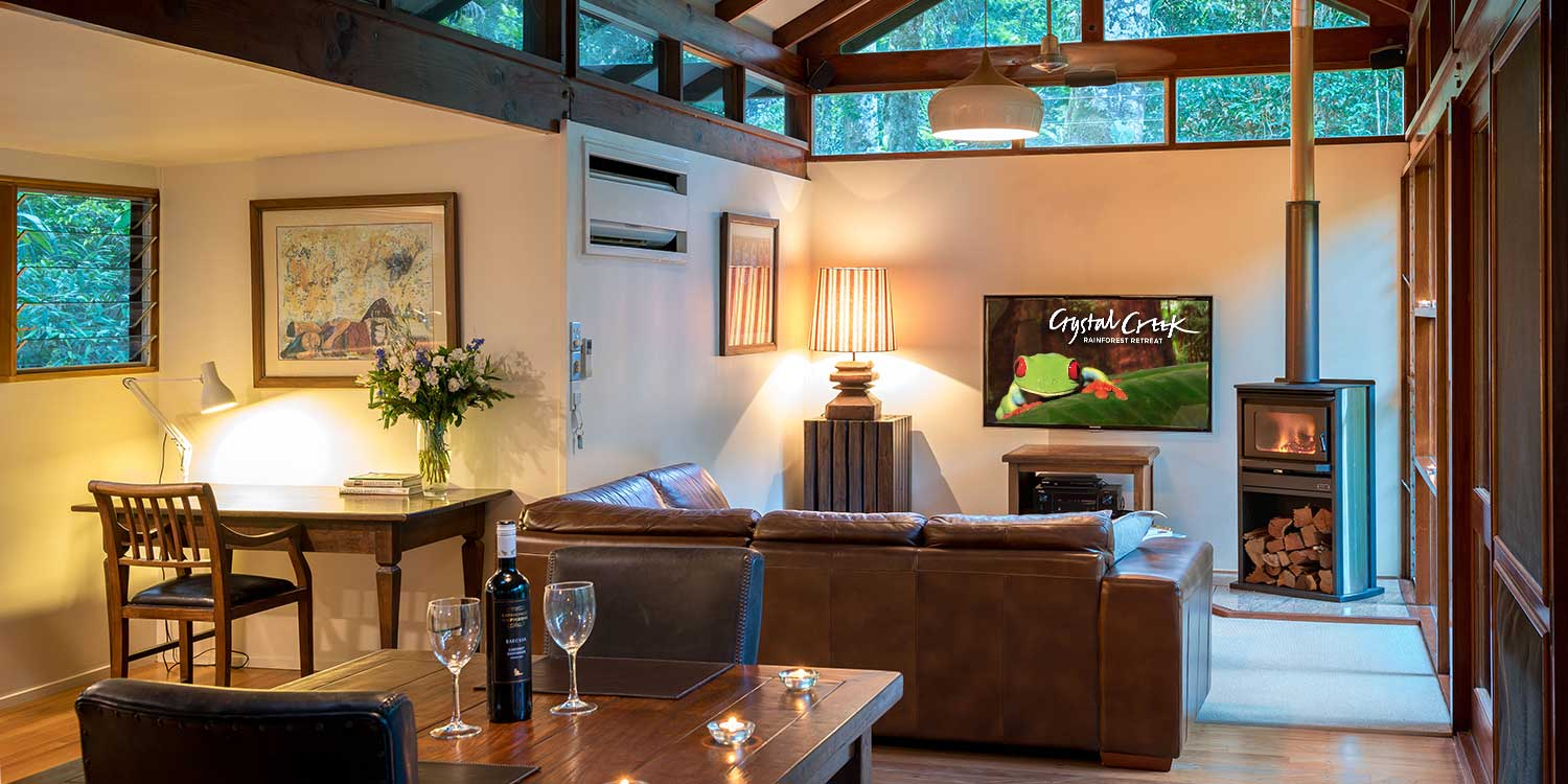 The Creekside Spa Cabins are cosy bungalows with fireplaces and floor-to-ceiling rainforest views.