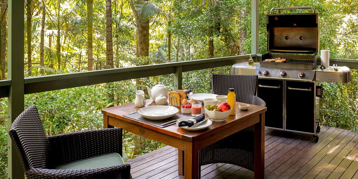 The private decks of the Creekside Spa Cabins are ideal for cooking the meat portions of your Breakfast Baskets on the barbecue and sitting down to a hearty rainforest morning meal