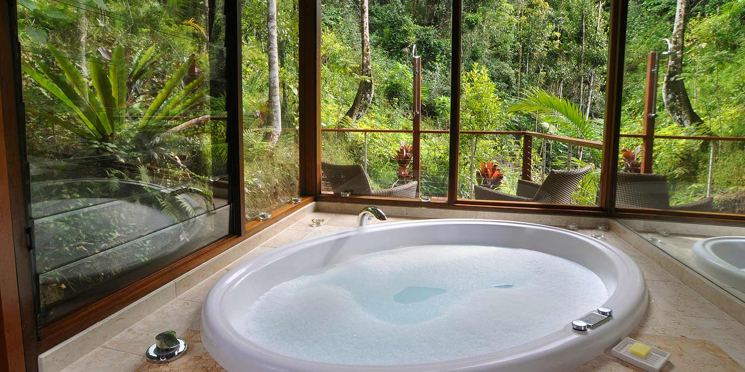 The Glass Terrace Bungalows have a double spa with floor-to-ceiling rainforest views and an outdoor shower
