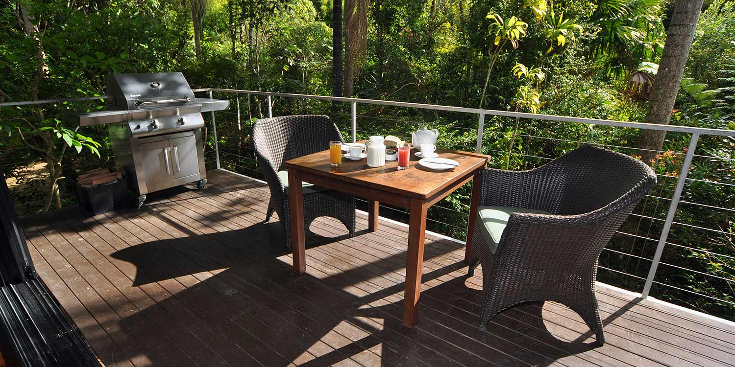 Breakfast on the covered private deck, cooked on the stainless steel BBQ, brings the rainforest to you in a Glass Terrace Bungalow