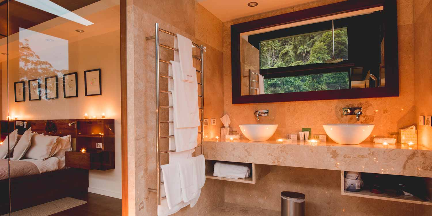 The Luxury Mountain View Lodges have a spacious marble bathroom with views to the rainforest and heated towel racks