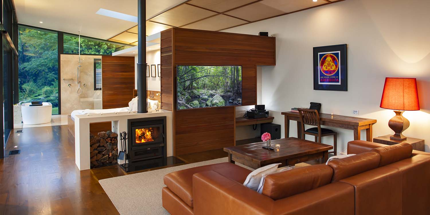 Luxury Mountain View Lodges have double-sided fireplaces for the cooler seasons warming both bed and lounge areas