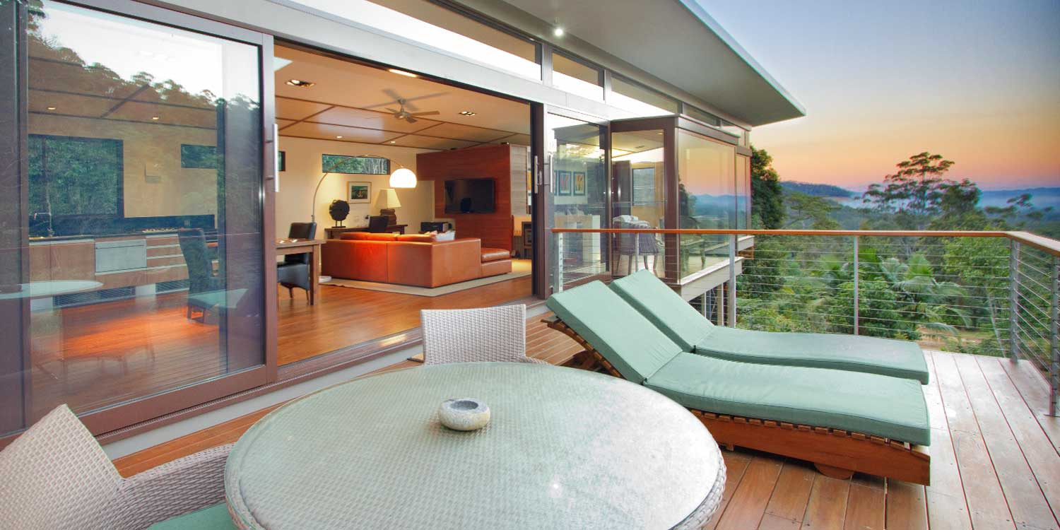 Luxury Mountain View Lodges have aspects over the rainforest valley from their private decks