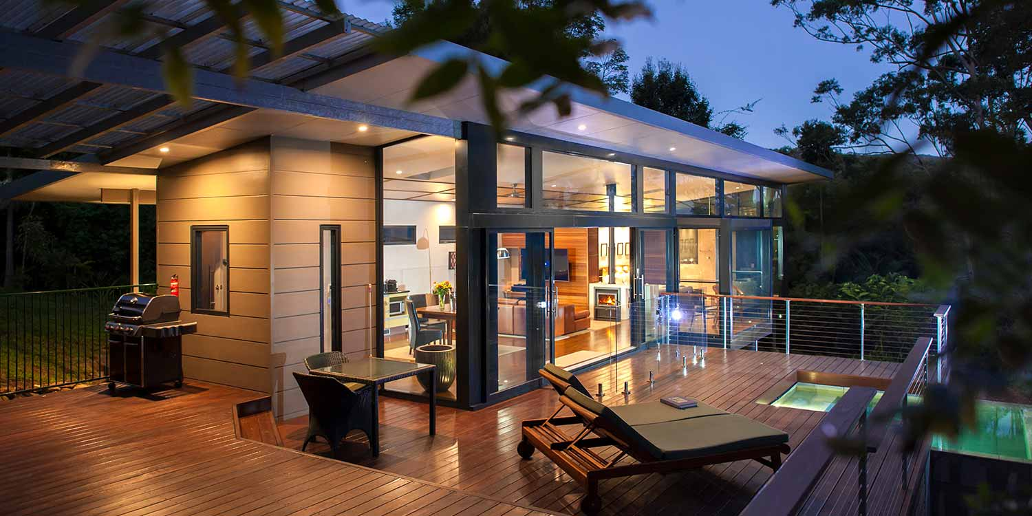 The private decks of the Luxury Mountain View Lodges are a great place to spend the evening in the rainforest near Byron Bay
