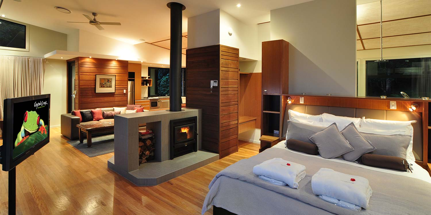 Luxury Rainforest Lodge –  double-sided fireplace warms both lounge and bed in the cooler months