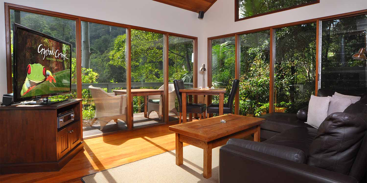 The Rainforest Canopy Bungalow has a mezzanine design and a DCD/TV set-up in the light-flooded living area