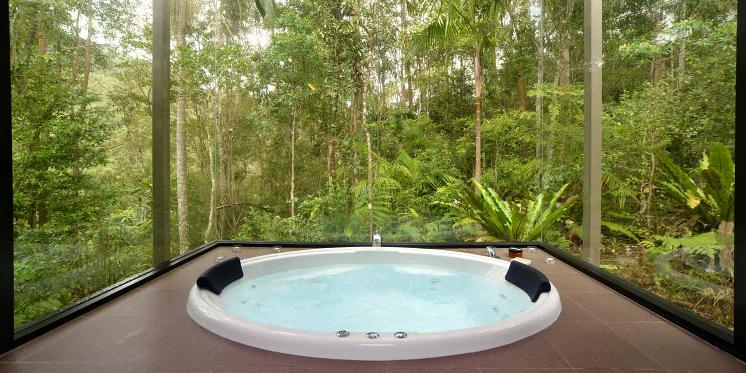 Rainforest Canopy Bungalow bathrooms have double spa baths with floor to ceiling rainforest views on three sides