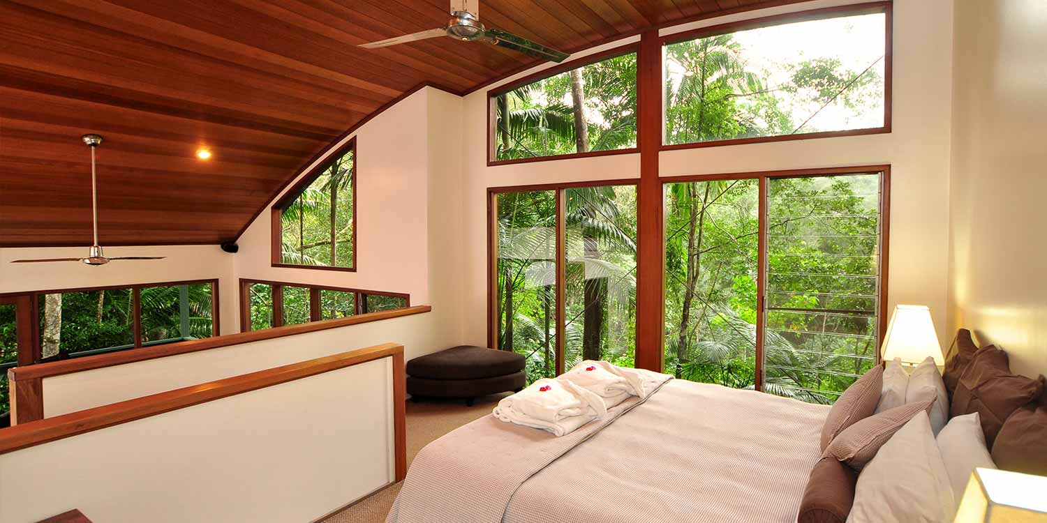 The sweeping curves of the oak-lined roof is a major feature of the Rainforest Canopy Bungalows, a relaxing romantic getaway in the Far North Coast of New South Wales