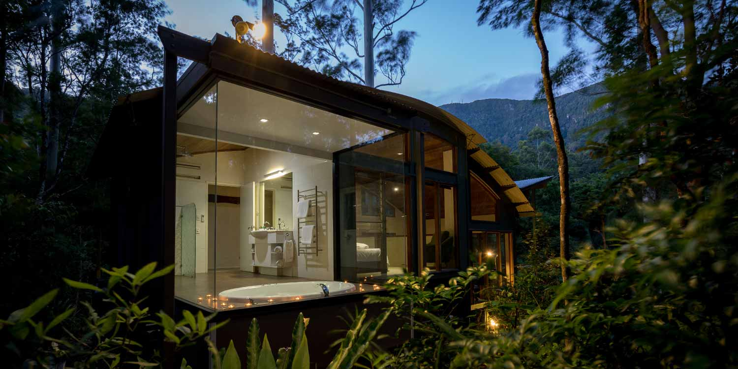 Rainforest Canopy Bungalow has a sunken double spa bath with floor-to-ceiling rainforest on three sides