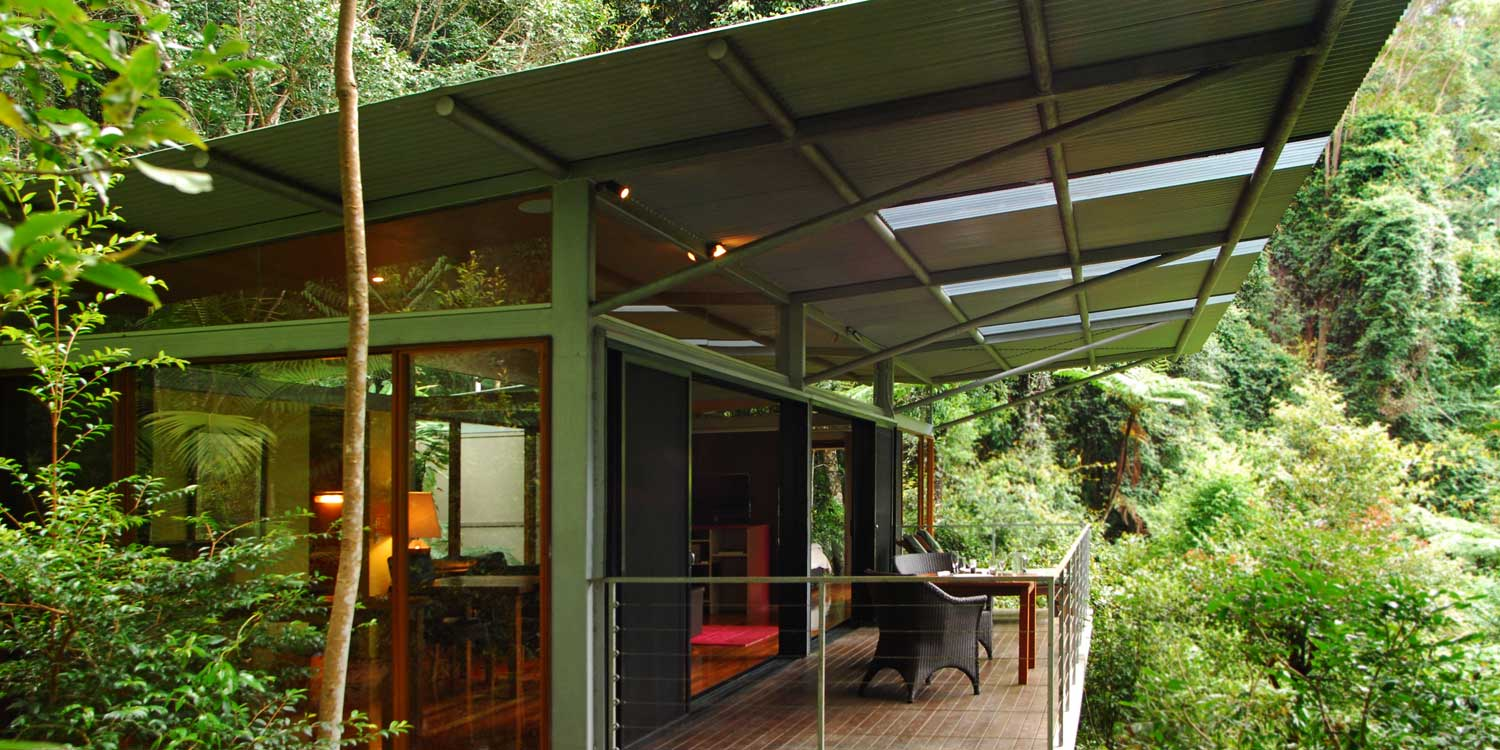 Glass Terrace Bungalow is a skillion roof design with glass along the entire front looking out the rainforest