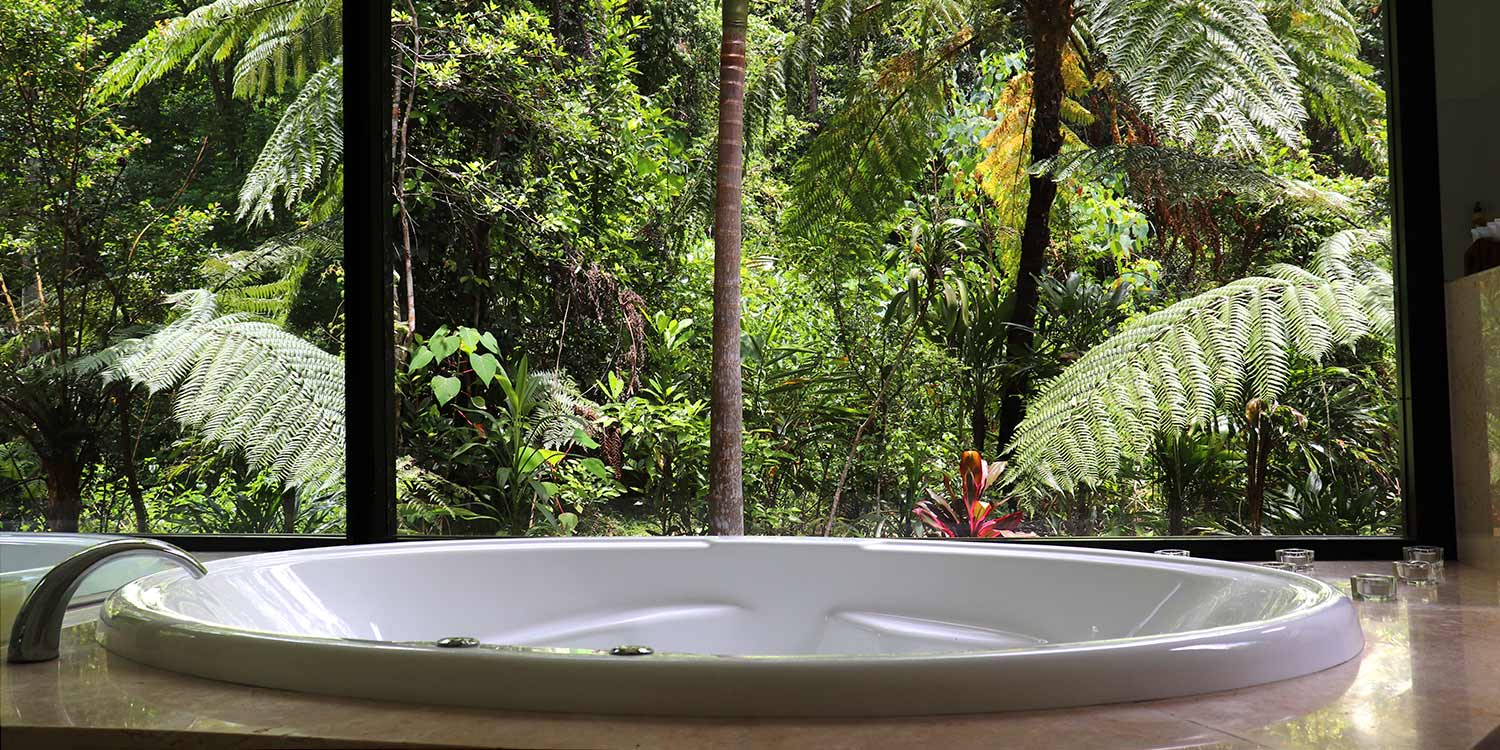 Tamarind, one of our Creekside Spa Cabins, has a marble bathroom with wide wheelchair clearances