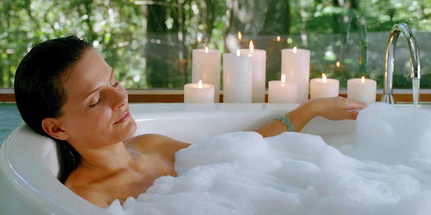 Relaxing in a luxurious sunken double spa is an essential part of your romantic getaway at Crystal Creek Rainforest Retreat
