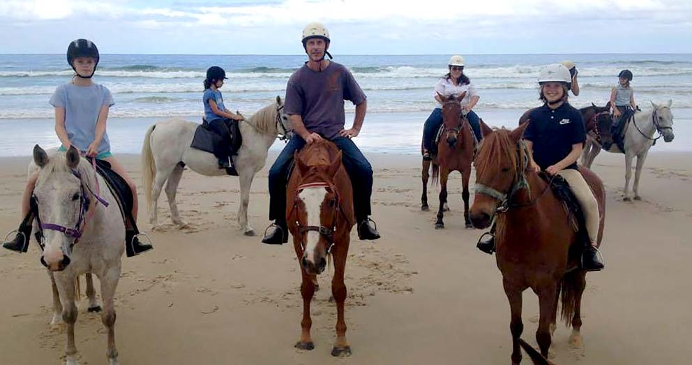 Ride horses along the beach at Byron Bay, just a day trip from Crystal Creek Rainforest Retreat